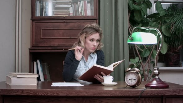 Thumbnail for Concentrated Young Woman Reading a Book