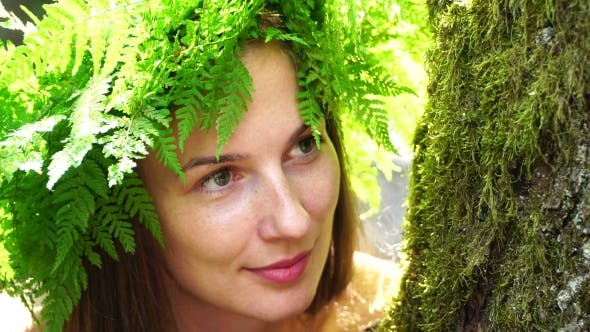 Thumbnail for Portrait of a Girl with a Wreath on His Head. Beautiful White Girl with Freckles, a Wreath of Fern