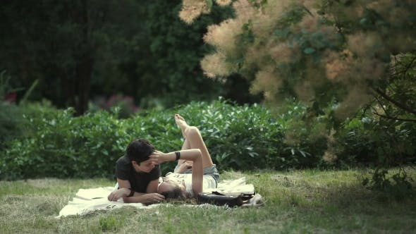 Thumbnail for Couple of Lesbians Laying on the Grass in the Park