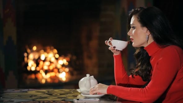 Thumbnail for Profile of Brunette in Red Sweater, Drinking Tea Indoor.
