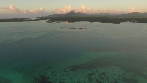 Thumbnail for Aerial View of Ocean Blue Water with Waves, Corals and Water Plants, Camera Moving To Coast