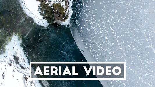 Thumbnail for Straight Down Aerial Video of Person lying on a Frozen Lake