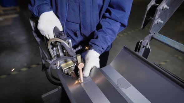 Thumbnail for Work Using Mechanized Hand for Spot Welding of Metal izdeliy.Muzhchina Working in a Factory with a