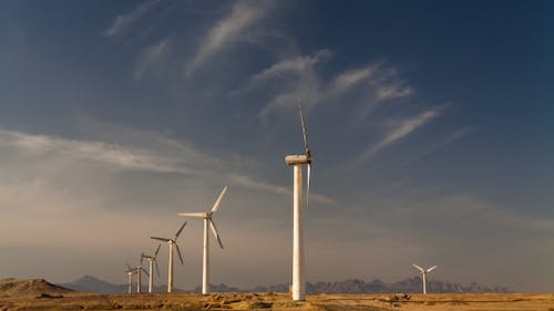 Wind Turbines on a Background of Blue Sky with Clouds