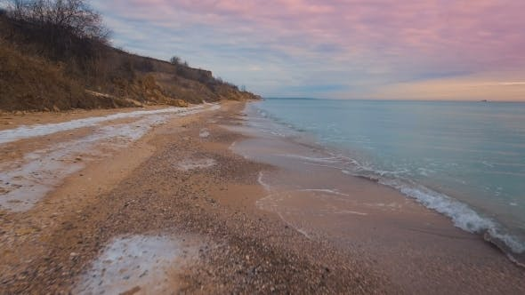Thumbnail for Epic Flying Drone To Over the Winter Beach During a Beautiful Pink Sunset. .