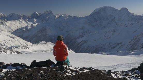 Woman Enjoying the View of Winter Mountains