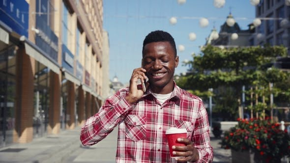 Thumbnail for Cheerful Guy Talking on His Cell Phone