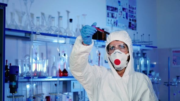 Thumbnail for Lab Worker Examines a Test Tube