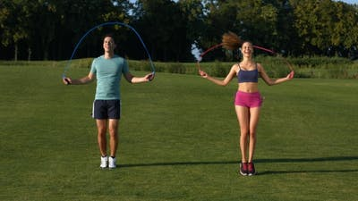 Guy and  Girl Are Jumping on the Jump Rope