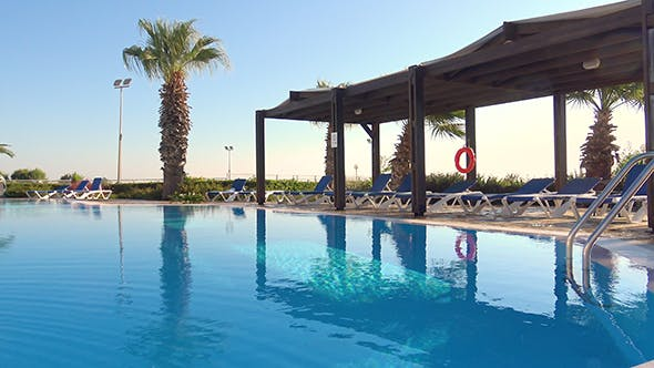 Swimming Pool And Lounge Chairs At Resort