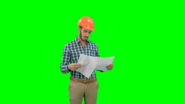 Thumbnail for Engineer in Hardhat Looking at Construction Plan