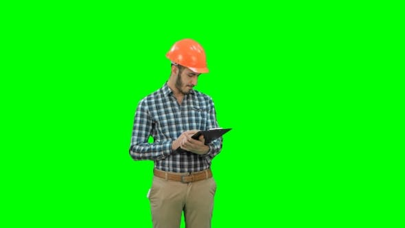 Thumbnail for Civil Engineer Filing in Inspection Form on a Green Screen, Chroma Key