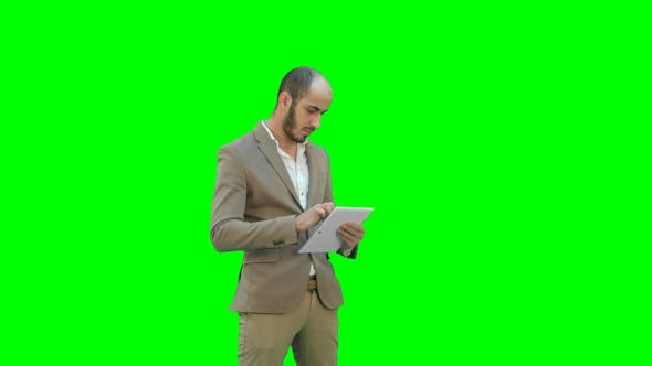 Thumbnail for Young Businessman Using Tablet Computer