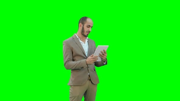 Thumbnail for Businessman Making Video Call on Tablet Computer
