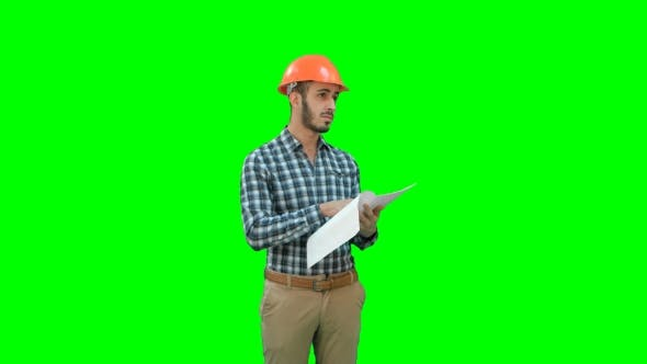 Thumbnail for Young Engineer in Helmet Checking Construction Plan on a Green Screen, Chroma Key