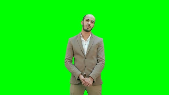 Thumbnail for Businessman Presenting Project Looking at Camera on a Green Screen, Chroma Key