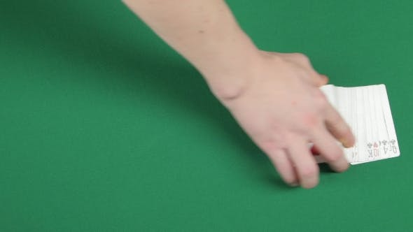 Thumbnail for Playing Cards Being Spread on a Green Surface By Magician