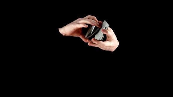 Thumbnail for Magician Continue Showing His Trick with Cards, Cardistry on Black