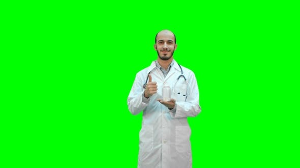 Thumbnail for Smiling Doctor Recommending Pills and Showing a Thumb Up
