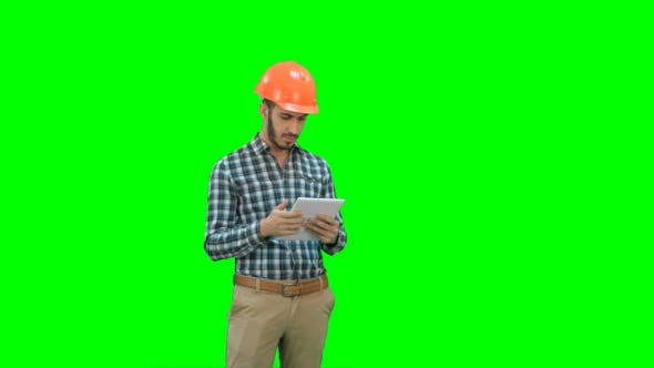 Thumbnail for Modern Engineer Using a Wireless Tablet To Check Construction Project on a Green Screen, Chroma Key.