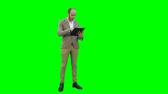 Thumbnail for Concentrated Businessman Reading Important Report