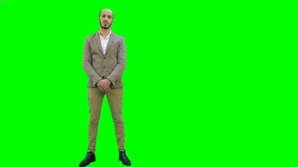 Thumbnail for Businessman Presenting Project To the Camera on a Green Screen, Chroma Key.