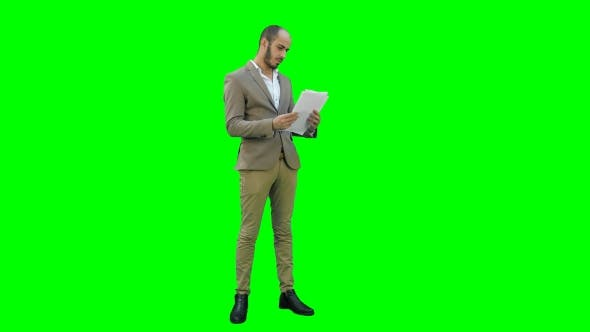 Thumbnail for Young Businessman Attentively Studying Documents