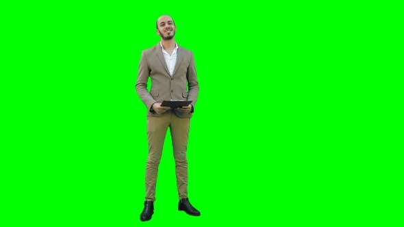 Thumbnail for Happy Young Man Making Business Presentation on a Green Screen, Chroma Key.