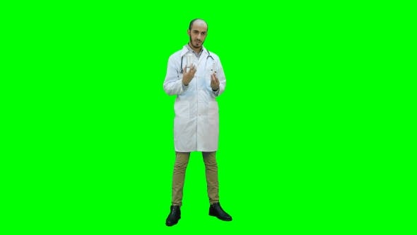 Thumbnail for Male Doctor Describing Two Different Pills on a Green Screen, Chroma Key.
