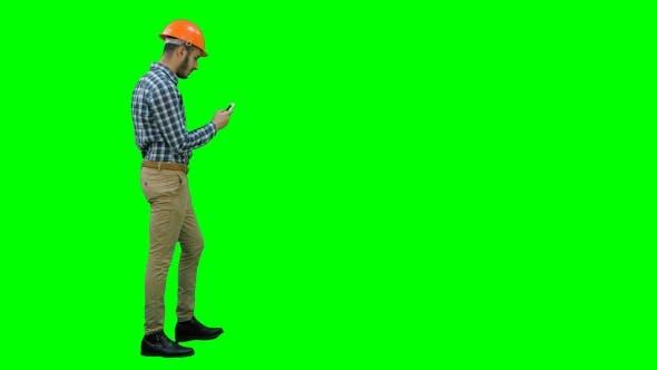 Thumbnail for Civil Engineer in Helmet Using Mobile Phone