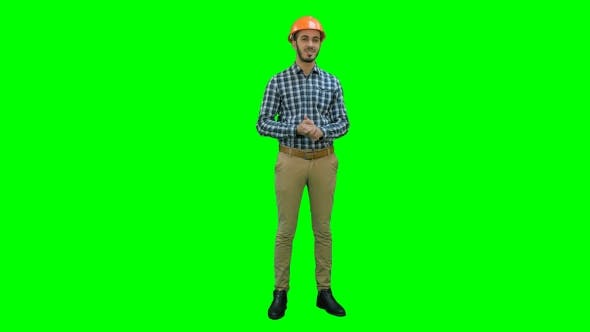 Thumbnail for Happy Young Engineer Wearing Helmet Talking To the Camera on a Green Screen, Chroma Key.