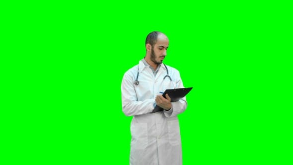 Thumbnail for Male Doctor in White Coat Filling in Prescription Form