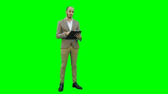 Thumbnail for Manager Holding Clipboard and Presenting Business Report on a Green Screen, Chroma Key.