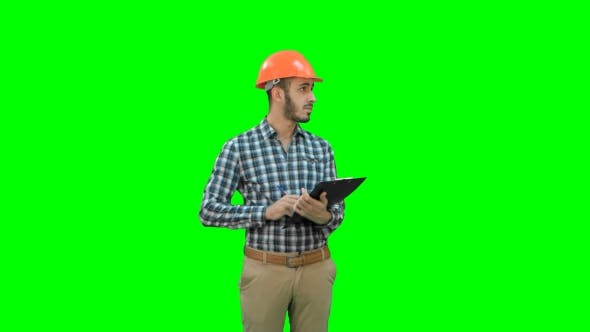 Thumbnail for Young Engineer in Helmet Inspecting Construction Site on a Green Screen, Chroma Key.