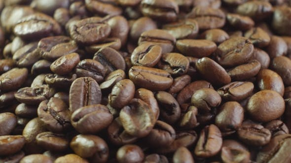 Thumbnail for Coffee Beans. Loopable Rotation. Front of the Camera Rotates Plate with Coffee Beans