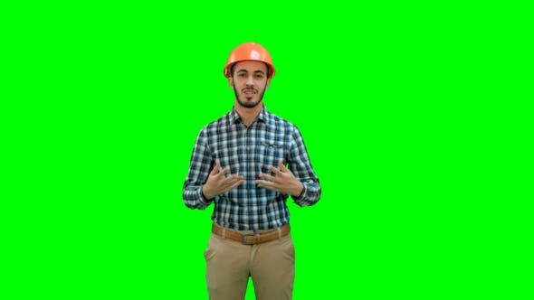 Thumbnail for Happy Young Engineer in Helmet Talking To the Camera