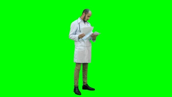 Thumbnail for Male Doctor Checking Medical Documents on a Green Screen, Chroma Key.