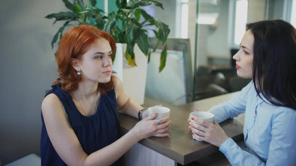 Thumbnail for Two Young Beautiful Women Talk Over Cup of Coffee