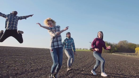 Thumbnail for Excited Group in Empty Cultivated Field