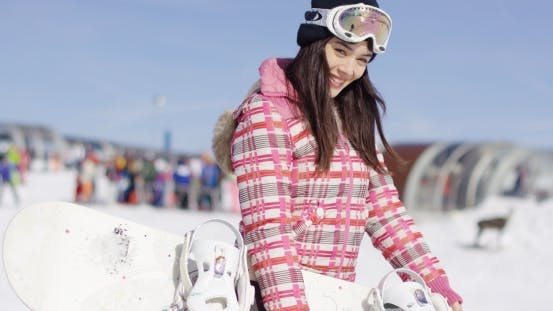 Thumbnail for Young Smiling Woman with Ski Boots