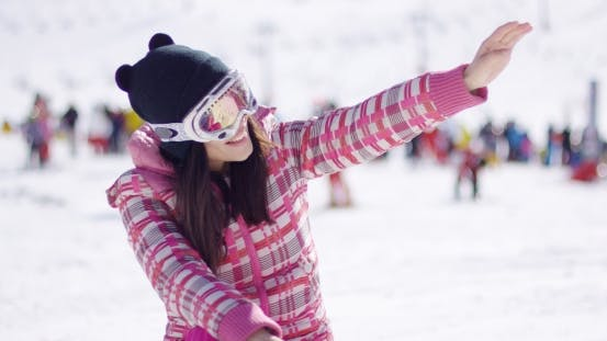 Thumbnail for Happy Woman on Ski Holiday Waving