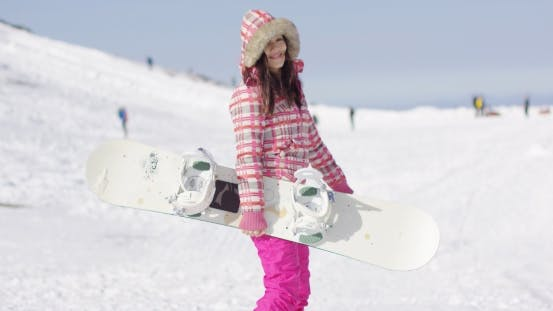 Thumbnail for Happy Cute Female Snowboarder on Ski Slope.
