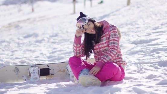 Thumbnail for Young Woman on Ski Slope with Snowboard