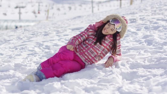 Thumbnail for Young Woman in Pink Snowsuit with Ski Goggles