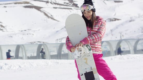 Thumbnail for Pretty Young Asian Woman Holding Snowboard