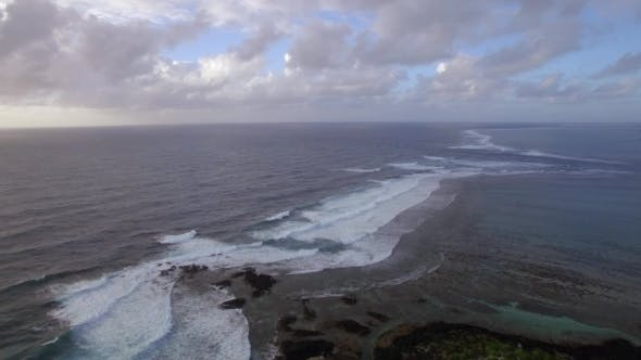 Thumbnail for Aerial View of Water Line of Seas That Do Not Mix Against Blue Sky with Clouds, Mauritius Island