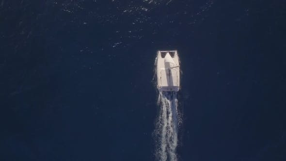Thumbnail for Aerial Top View of Sailing White Yacht in Empty Ocean Blue Water, Mauritius Island