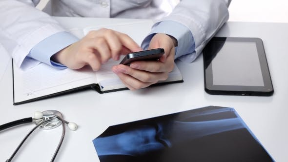 Thumbnail for Doctor Texting on Mobile Phone, White