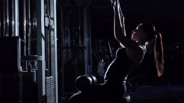 Thumbnail for Woman in the Gym Doing Pulldown Exercises To Front in Silhouette