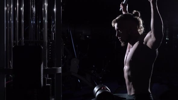 Thumbnail for Young Man Doing Lats Pulldown Exercises To Back in Gum